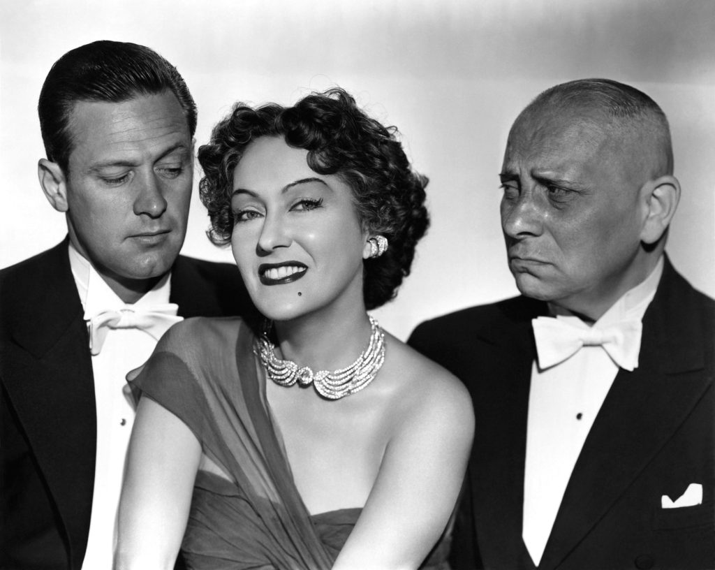 L to R: William Holden as Joe Gillis, Gloria Swanson as Norma Desmond, and Erich von Stroheim as Max von Mayerling