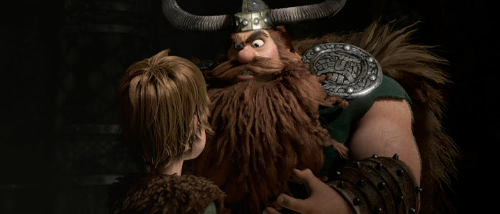 Hiccup (Jay Baruchel) in the shadow of his father, Stoick the Vast (Gerard Butler)