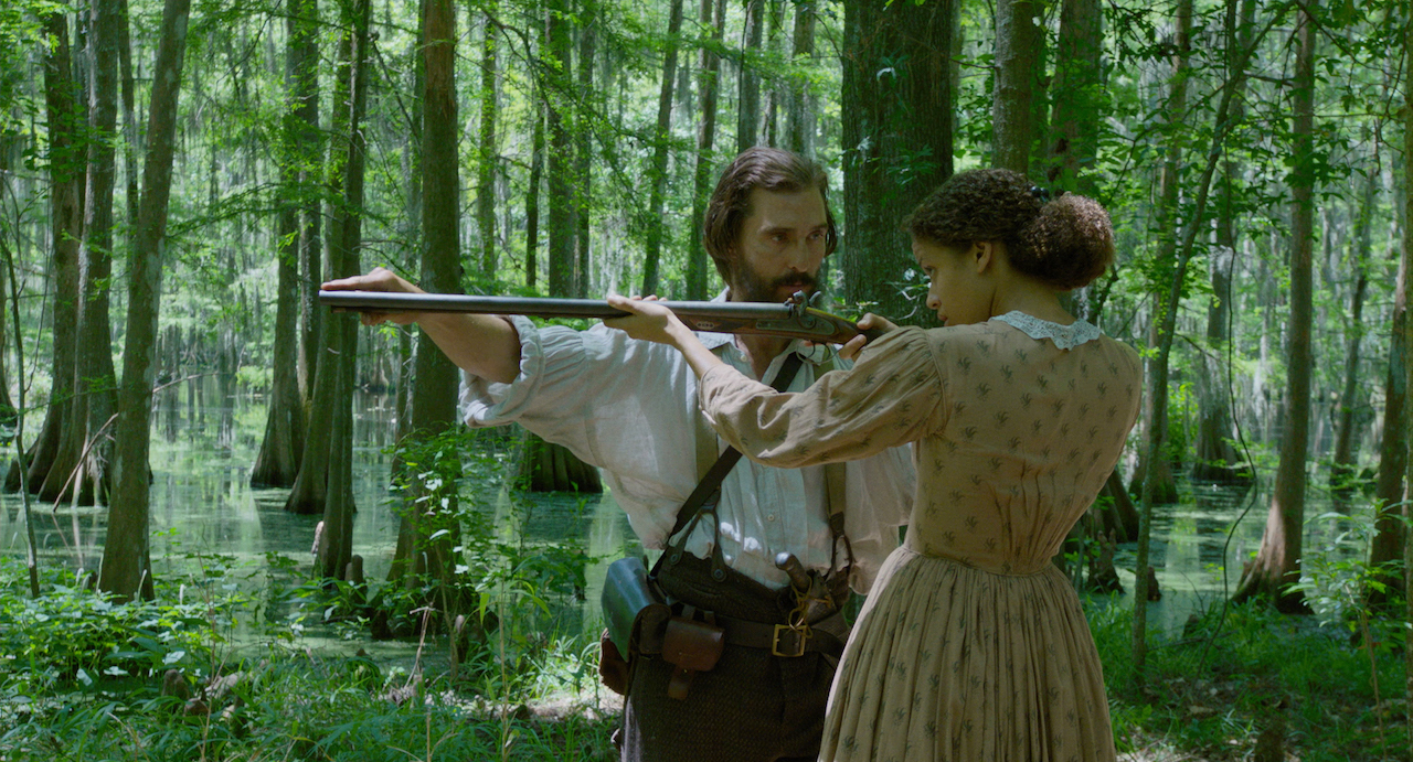 Shooting lessons for all in FREE STATE OF JONES. McConaughey with Gugu-Mbatha-Raw.