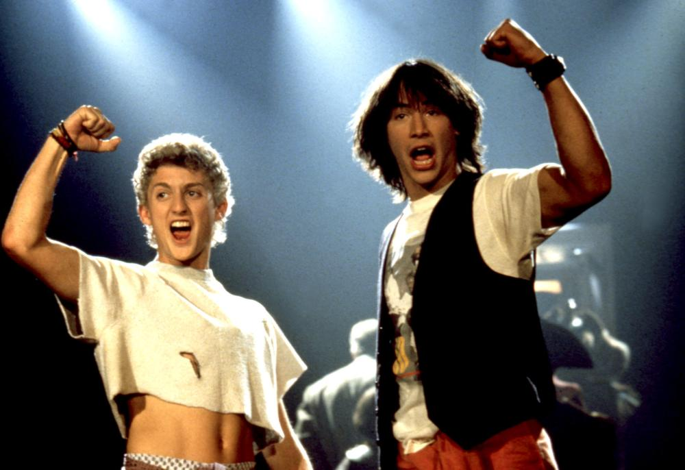BILL AND TED'S EXCELLENT ADVENTURE, Alex Winter, Keanu Reeves, 1989, raised fist