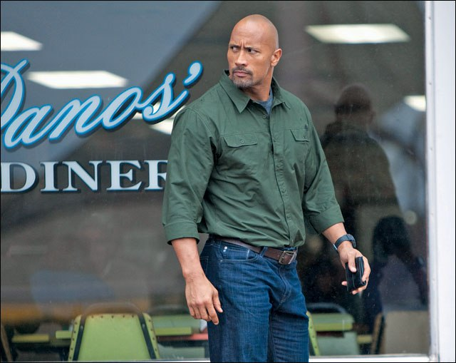 The Rock smells what the diner is cooking.
