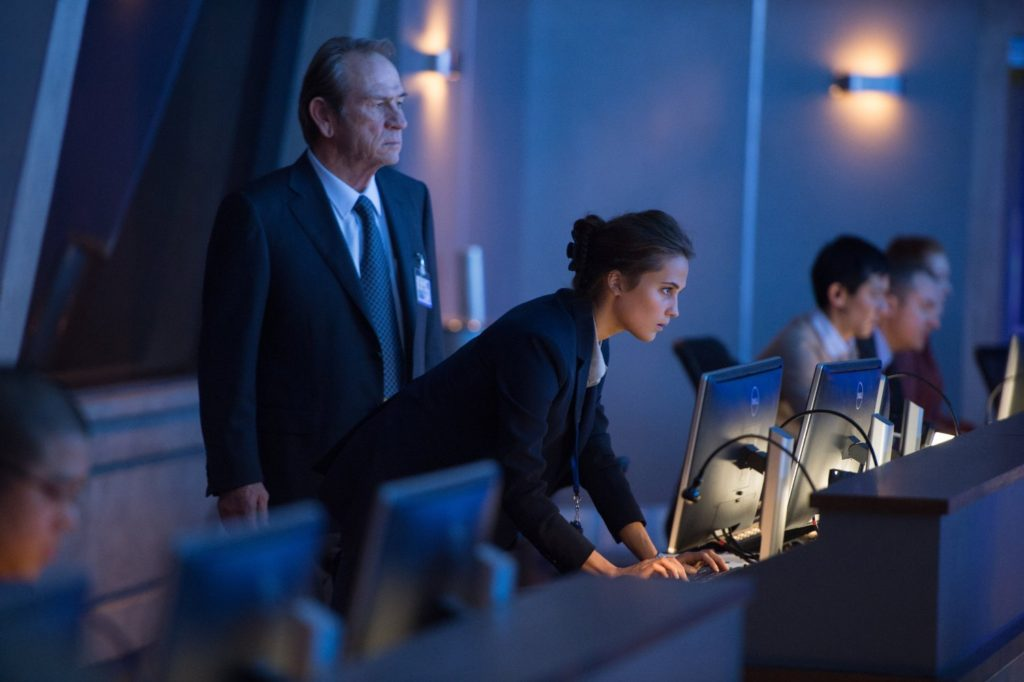 Tony Lee Jones and Alicia Vikander work the control room in JASON BOURNE.