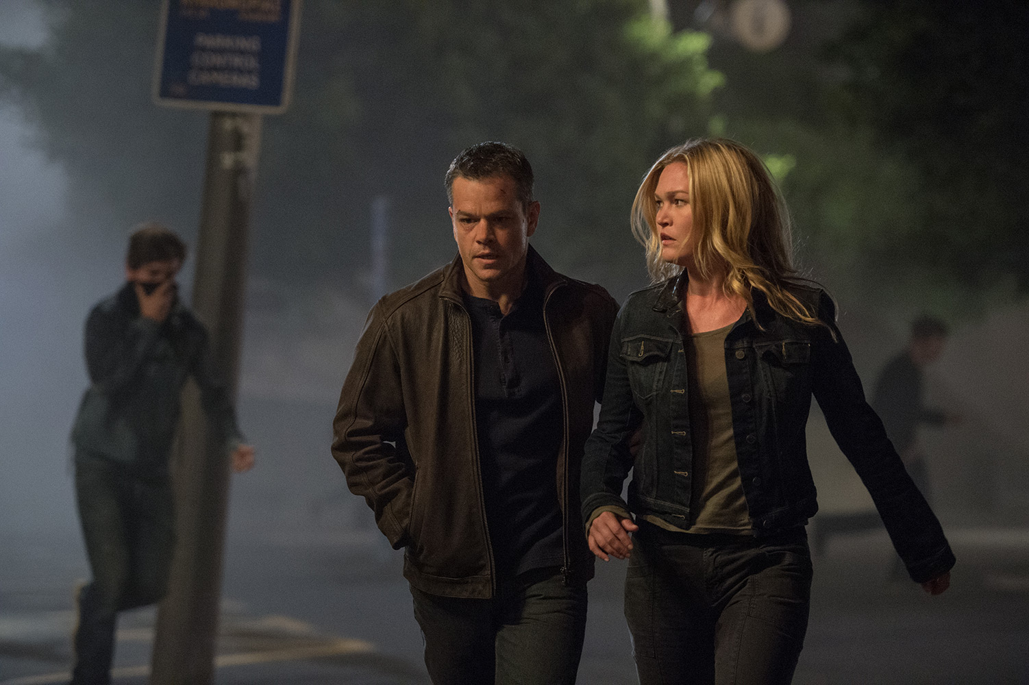 Matt Damon and Julia Stiles walk the streets of Athens in Jason Bourne (2016)