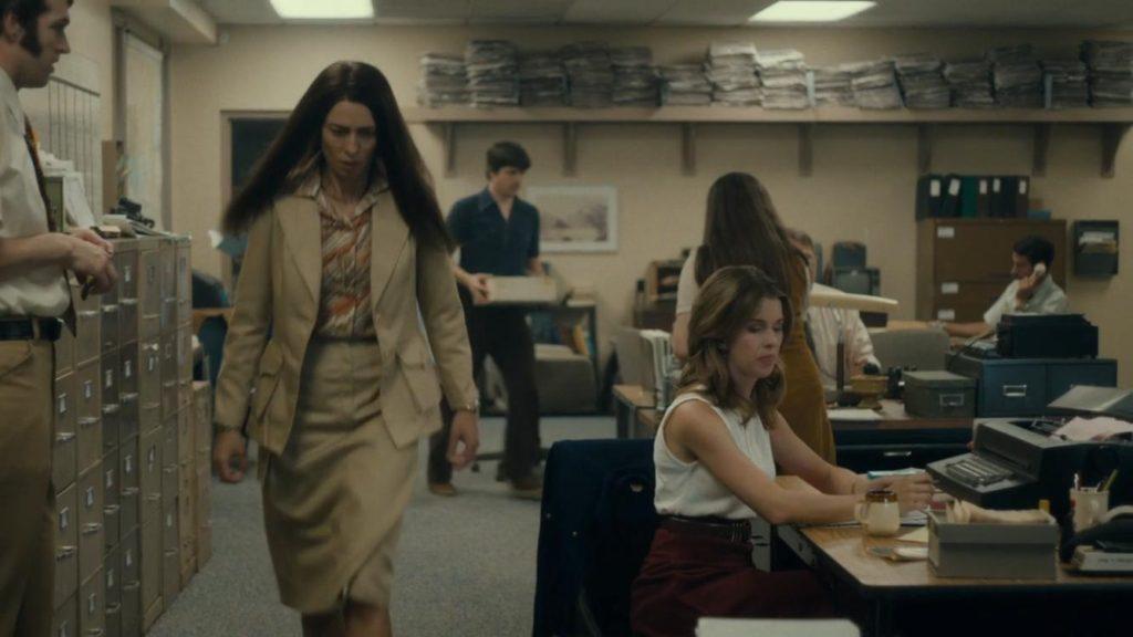 Rebecca Hall as Christine, storming through the newsroom.