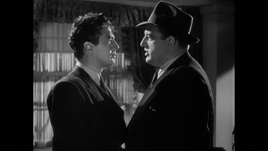 Victor Mature can't shake Laird Cregar.