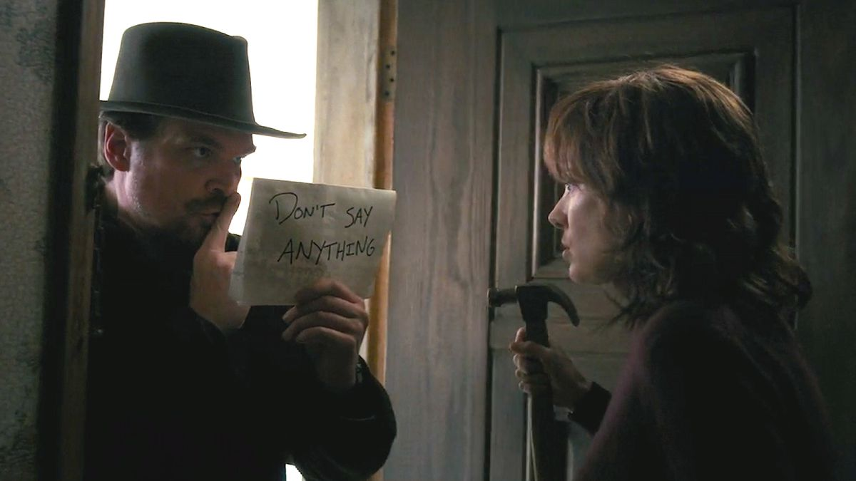 David Harbour as Chief Jim Hopper and Winona Ryder as Joyce Byers in STRANGER THINGS (2016)