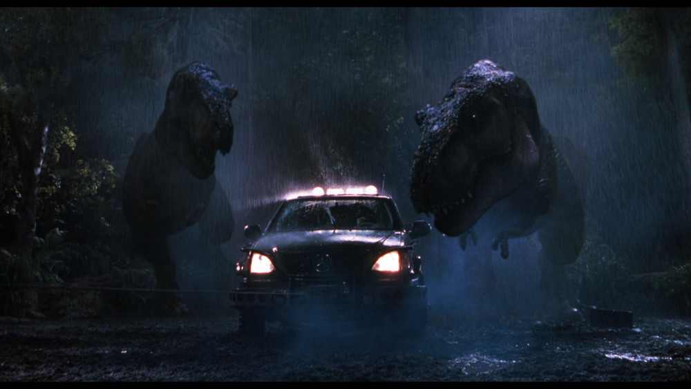 Two T-Rexes chase down a car in THE LOST WORLD: JURASSIC PARK (1997)