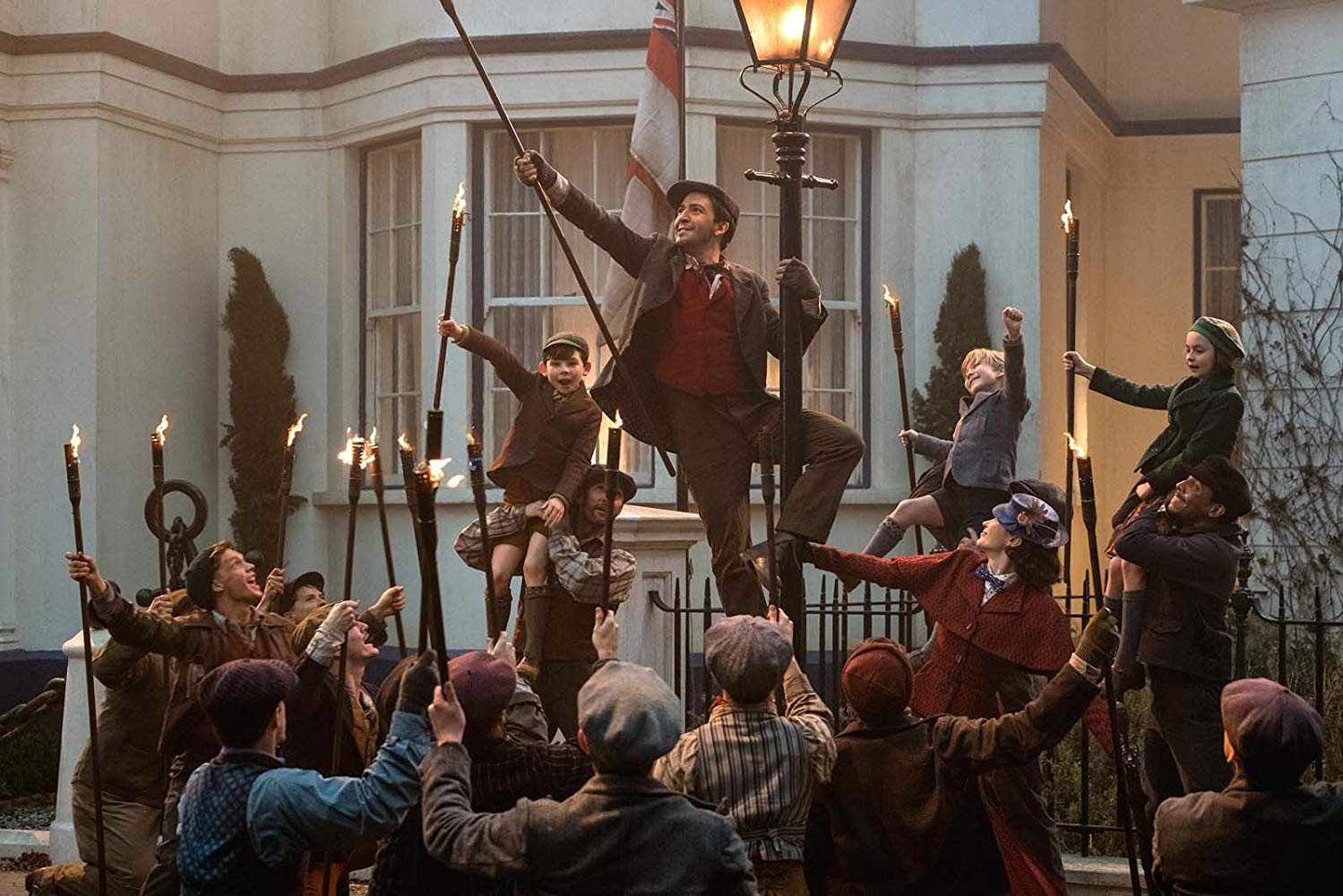 "Lin-Manuel Miranda's Jack leads the lamplighters and the Banks children in ""Trip a Little Light Fantastic"" in MARY POPPINS RETURNS (2018)"